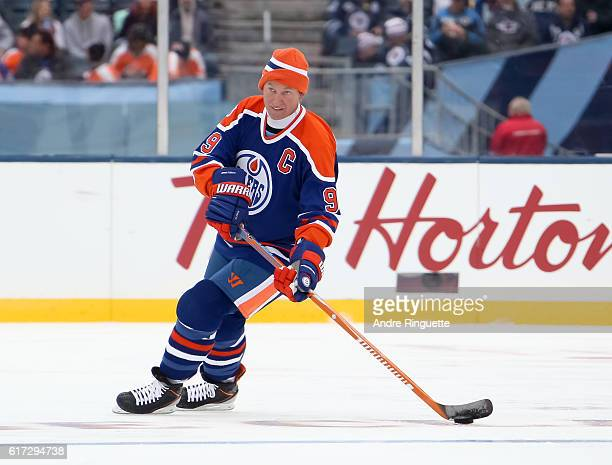 Wayne Gretzky of the Edmonton Oilers alumni stickhandles the puck against Winnipeg Jets alumni during the 2016 Tim Hortons NHL Heritage Classic...