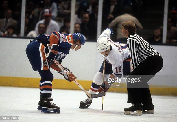 Wayne Gretzky of the Edmonton Oilers and Bryan Trottier of the New York Islanders wait for the faceoff during the 1983 Stanley Cup Finals in May 1983...