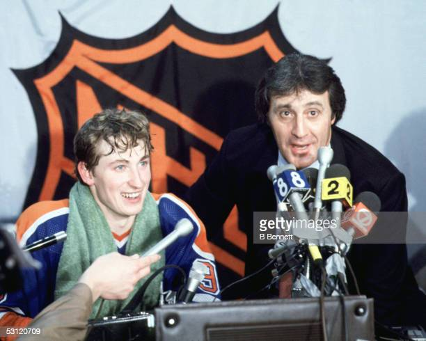 Wayne Gretzky of the Edmonton Oilers and Phil Esposito talk to reporters during the 77th goal press conference on February 24, 1982 at Buffalo...
