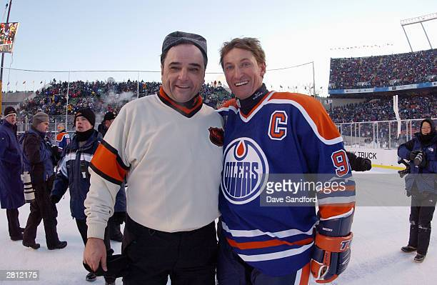 Wayne Gretzky of the Edmonton Oilers and referee Andy Van Hellemond pose for a photo during the Molson Canadien Heritage Classic on November 22 2003...