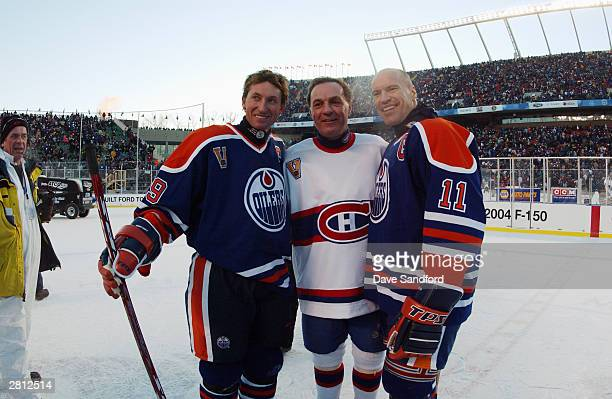 Wayne Gretzky of the Edmonton Oilers and teammate Mark Messier pose for a photo with Guy Lafleur of the Montreal Canadiens during the Molson Canadien...