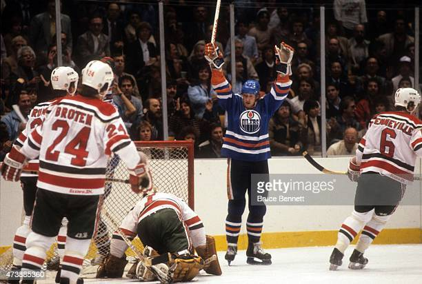 Wayne Gretzky of the Edmonton Oilers celebrates a goal against Murray Brumwell Aaron Broten Joel Quenneville and goalie Glenn Chico Resch of the New...