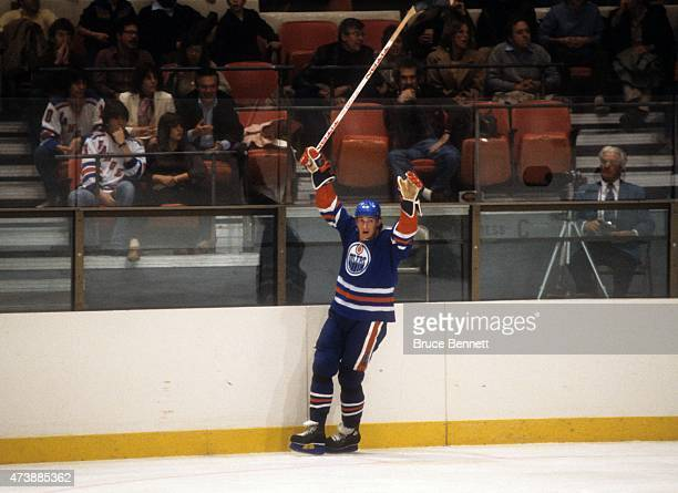 Wayne Gretzky of the Edmonton Oilers celebrates a goal during an NHL game against the New York Rangers on November 14 1982 at the Madison Square...