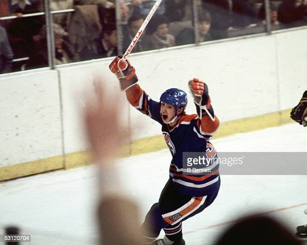 Wayne Gretzky of the Edmonton Oilers celebrates after scoring his 77th goal against goalie Don Edwards of the Buffalo Sabres during their game on...