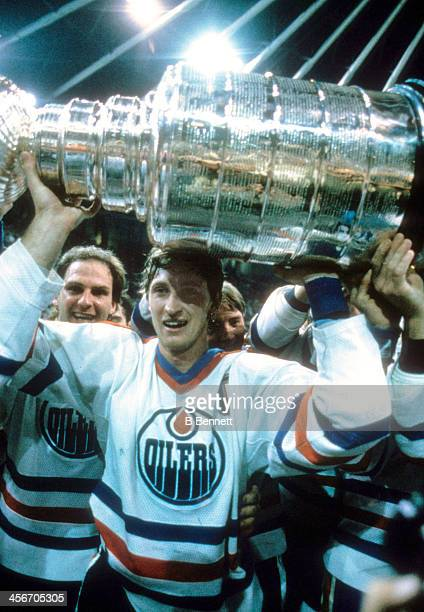 Wayne Gretzky of the Edmonton Oilers celebrates with the Stanley Cup Trophy after the Oilers defeated the New York Islanders in Game 5 of the 1984...