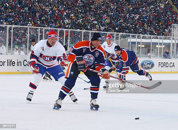 Wayne Gretzky of the Edmonton Oilers chases after the puck during the Molson Canadien Heritage Classic against the Montreal Canadiens on November 22...