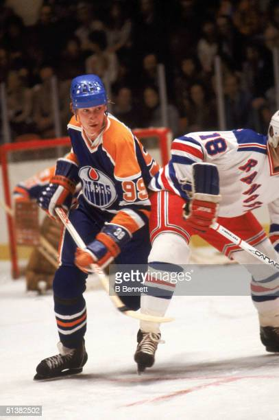Wayne Gretzky of the Edmonton Oilers checks a New York Rangers player on the ice at Madison Square Garden in New York New York Wayne Gretzky played...