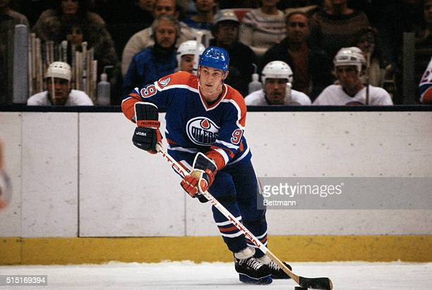 Wayne Gretzky of the Edmonton Oilers controls the puck during a game at Nassau Coliseum on Long Island in New York