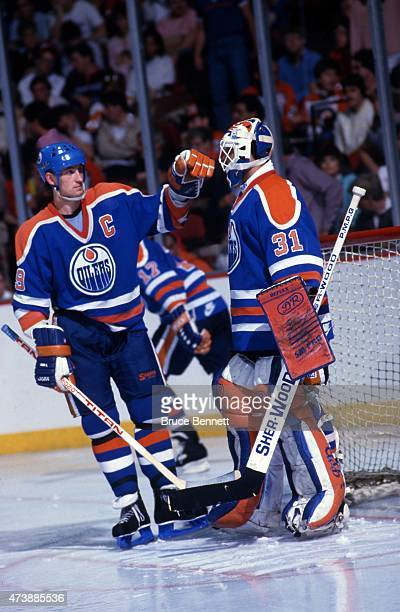 Wayne Gretzky of the Edmonton Oilers encourages goalie Grant Fuhr before a 1987 Stanley Cup Finals game against the Philadelphia Flyers in May 1987...
