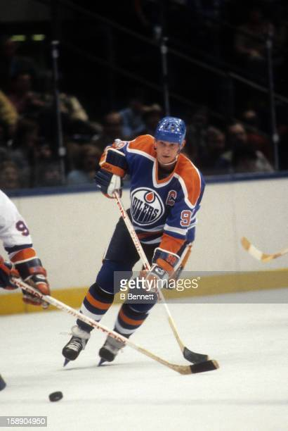 Wayne Gretzky of the Edmonton Oilers goes for the puck during an NHL game against the New York Islanders on December 13 1983 at the Nassau Coliseum...