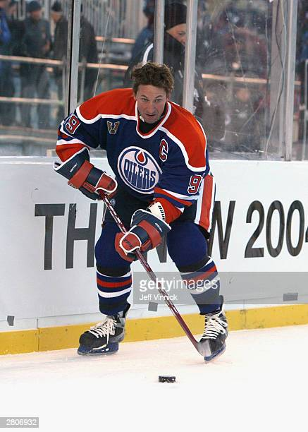Wayne Gretzky of the Edmonton Oilers looks to make a play from behind the net against the Montreal Canadiens during the Molson Canadien Heritage...