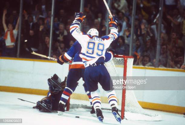 Wayne Gretzky of the Edmonton Oilers scores a goal against the New York Islanders in the 1984 NHL Stanley Cup Finals on May 19, 1984 at the...