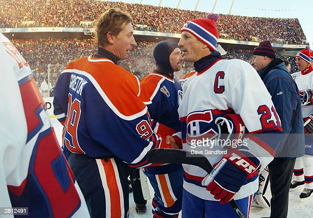 Wayne Gretzky of the Edmonton Oilers shakes hands with Guy Carbonneau of the Montreal Canadiens during the Molson Canadien Heritage Classic on...