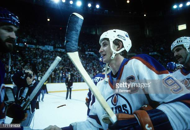 Wayne Gretzky of the Edmonton Oilers shakes hands with Ken Morrow of the New York Islanders after the Oilers defeated the Islanders in Game 5 of the...