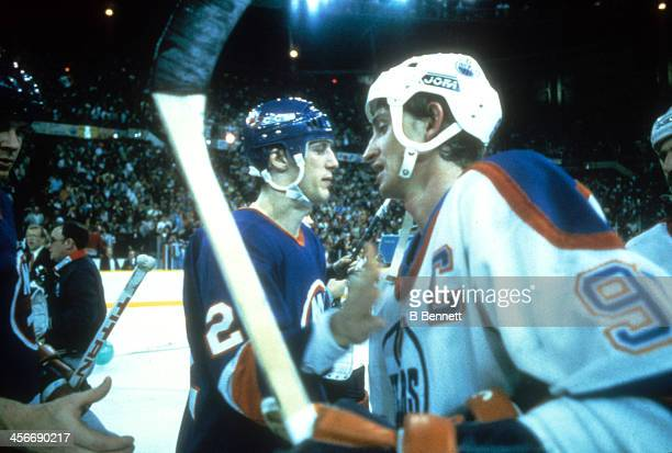Wayne Gretzky of the Edmonton Oilers shakes hands with Mike Bossy of the New York Islanders after the Oilers defeated the Islanders in Game 5 of the...