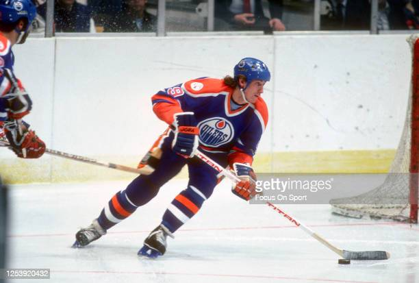Wayne Gretzky of the Edmonton Oilers skates against the New Jersey Devils during an NHL Hockey game circa 1983 at the Brendan Byrne Arena in East...