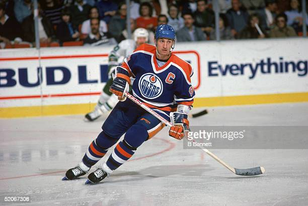 Wayne Gretzky of the Edmonton Oilers skates on the ice during an NHL game against the Hartford Whalers on November 15, 1986 at the Hartford Civic...