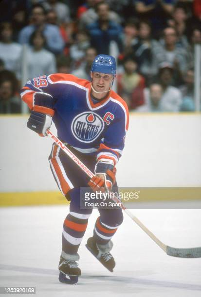 Wayne Gretzky of the Edmonton Oilers skates the New Jersey Devils during an NHL Hockey game circa 1984 at the Brendan Byrne Arena in East Rutherford,...