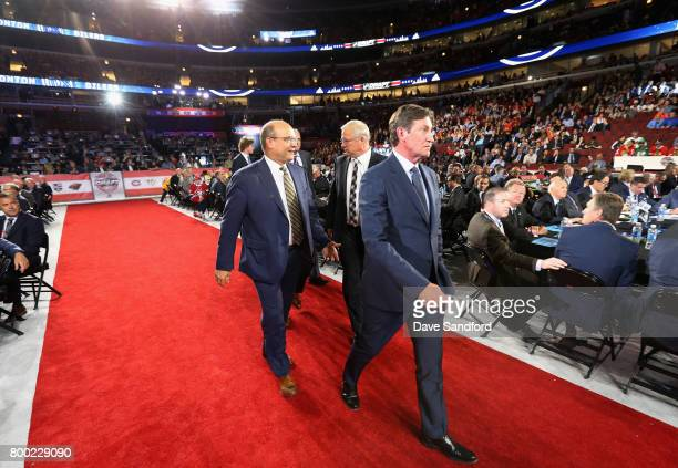 Wayne Gretzky of the Edmonton Oilers walks to the stage during Round One of the 2017 NHL Draft at United Center on June 23 2017 in Chicago Illinois