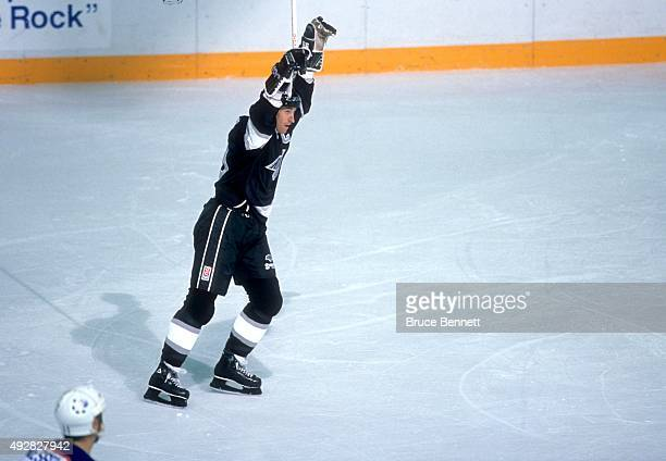 Wayne Gretzky of the Los Angeles Kings celebrates after the Kings scored and Gretzky tied Gordie Howes record with his 1850th career NHL point...