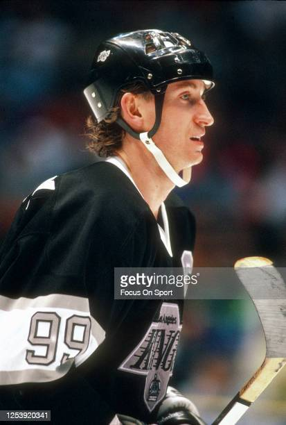 Wayne Gretzky of the Los Angeles Kings looks on against the New Jersey Devils during an NHL Hockey game circa 1991 at the Brendan Byrne Arena in East...