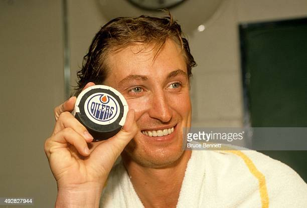 Wayne Gretzky of the Los Angeles Kings poses with the 1851 puck that Gretkzy scored with to pass Gordie Howe as the alltime point leader in the NHL...