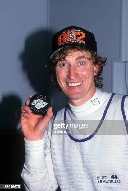 Wayne Gretzky of the Los Angeles Kings poses with the puck he scored his 802nd career goal with after the game against the Vancouver Canucks on March...