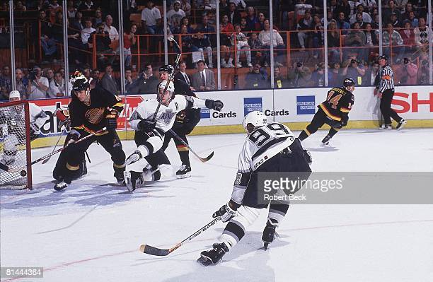 Wayne Gretzky of the Los Angeles Kings scores his 802nd goal against the Vancouver Canucks on March 23 1994 at the Great Western Forum in Inglewood...