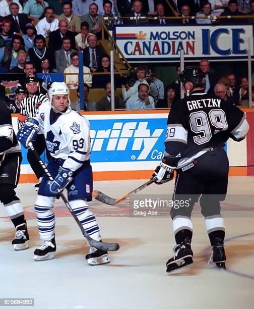 Wayne Gretzky of the Los Angeles Kings skates by Doug Gilmour of the Toronto Maple Leafs during NHL semi final series playoff game action on May 17...