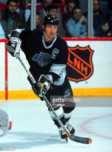 Wayne Gretzky of the Los Angeles Kings skates on the ice during an NHL game against the Montreal Canadiens circa 1990's at the Montreal Forum in...