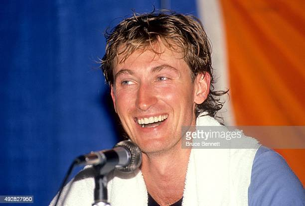 Wayne Gretzky of the Los Angeles Kings talks to the media after he scored his 1851st career NHL point against the Edmonton Oilers on October 15, 1989...