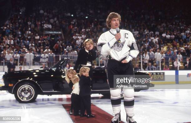 Wayne Gretzky of the Los Angeles Kings with his family on January 4 1993 at the Great Western Forum in Inglewood California