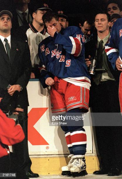 Wayne Gretzky of the New York Rangers becomes emotional during his retirement ceremony after playing in his final career game against the Pittsburgh...