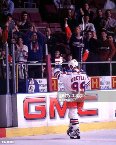 Wayne Gretzky of the New York Rangers is named star of the game as he acknowledges cheers of the MSG crowd on the night that he scored his 1072nd...