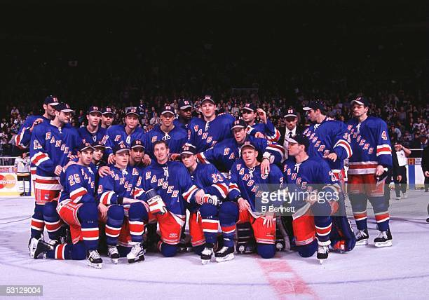 Wayne Gretzky of the New York Rangers poses with his teammates for a group shot after playing in his last NHL game against the Pittsburgh Penguins on...