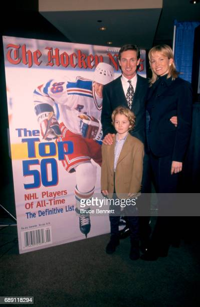 Wayne Gretzky of the New York Rangers stands with his wife Janet and son Ty during the press conference for Gretzky's retirement from the National...