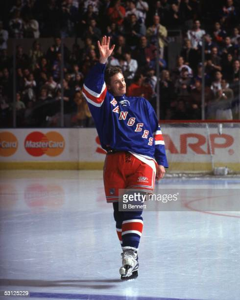 Wayne Gretzky of the New York Rangers waves to the crowd after playing his last NHL game against the Pittsburgh Penguins on April 18 1999 at the...