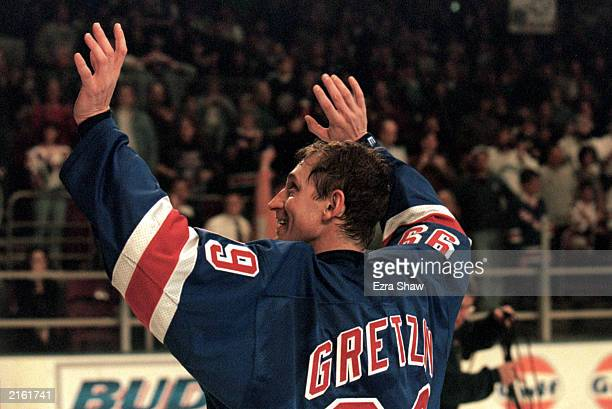 Wayne Gretzky of the New York Rangers waves to the crowd as he skates on the ice during retirement ceremonies after his final career game against the...
