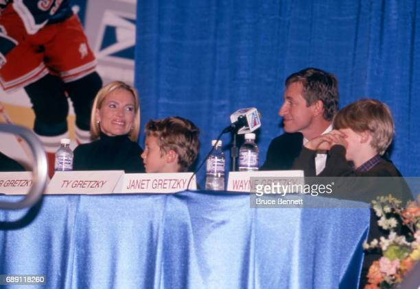 Wayne Gretzky of the New York Rangers with his wife and sons Janet Ty and Trevor talks to the media during the press conference for Gretzky's...