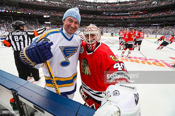 Wayne Gretzky of the St Louis Blues Alumni Team and goalie Darren Pang of the Chicago Blackhawks Alumni Team pose for a photo prior to the Alumni...