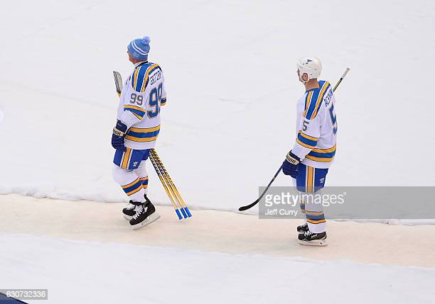 Wayne Gretzky of the St Louis Blues and Barrett Jackman of the St Louis Blues walk towards the ice during intermission during the 2017 Bridgestone...
