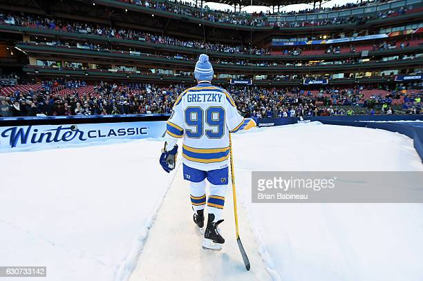 Wayne Gretzky of the St Louis Blues walks off the field after the 2017 Bridgestone NHL Winter Classic Alumni Game against the Chicago Blackhawks at...
