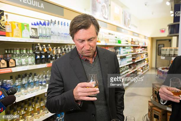TORONTO ON OCTOBER 17 Wayne Gretzky sniffs a shot of his new No 99 Canadian Whisky he launched at the Maple Leaf Square LCBO O