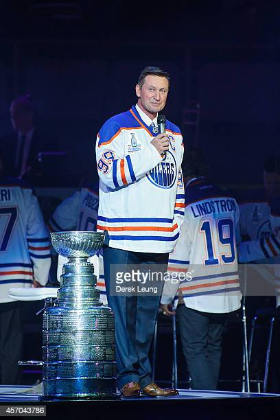 Wayne Gretzky talks to the crowd during the Edmonton Oilers Stanley Cup Reunion at Rexall Place on October 10 2014 in Edmonton Alberta Canada