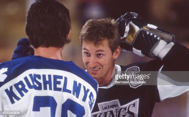 Wayne Gretzky talks with Mike Krushelnyski during warm ups on February 2 1992 at the Great Western Forum in Inglewood California