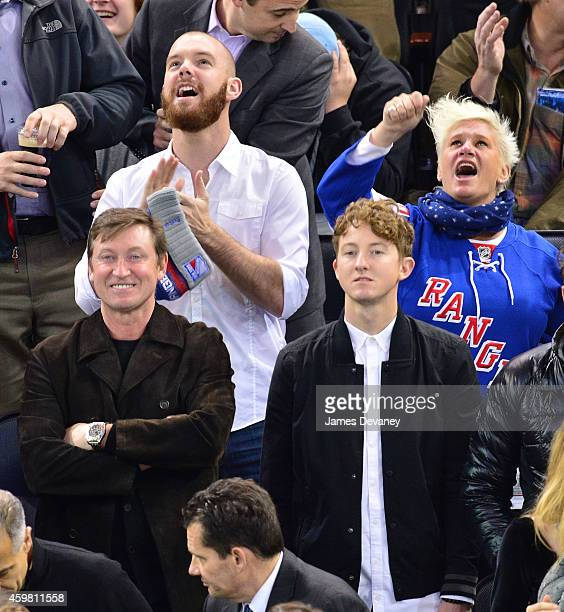 Wayne Gretzky Vic Black Ty Gretzky and Anne Burrell attend Tampa Bay Lighting vs New York Rangers game at Madison Square Garden on December 1 2014 in...