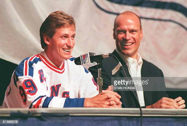 Wayne Gretzkywearing his usual number '99' jersey jokes with former Edmonton Oilers teammate Mark Messier 21 July at Madison Square Garden as the New...