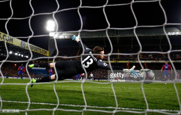 Wayne Hennessey of Crystal Palace attempts to save as Christian Eriksen of Tottenham Hotspur scores his sides first goal during the Premier League...
