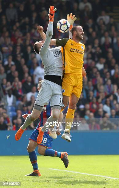Wayne Hennessey of Crystal Palace competes for the ball with Glenn Murray of Brighton and Hove Albion during the Premier League match between Crystal...