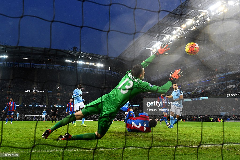 Wayne Hennessey of Crystal Palace dives in vain as Sergio Aguero of Manchester City scores during the Barclays Premier League match between Manchester City and Crystal Palace at Etihad Stadium on January 16, 2016 in Manchester, England.